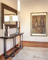 An organic mix of art and materials add texture to the entryway.