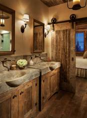 The master bathroom showcases a custom pair of pouredcement sinks.