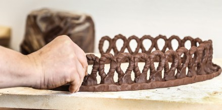 Starting the first row of a sculpture with coiled, textured parts.