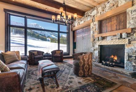 """""""The idea was to open the back of the house to views of Lone Peak by using a low shed roof, while keeping a low profile from the ski hill,"""" Brooks said of the ski lounge."""