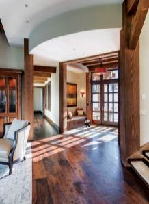 """""""We designed the ceiling to step up as you enter the main space from the entry hall,"""" said architect Bob Brooks. """"The ceiling opens up just as the views open up."""""""