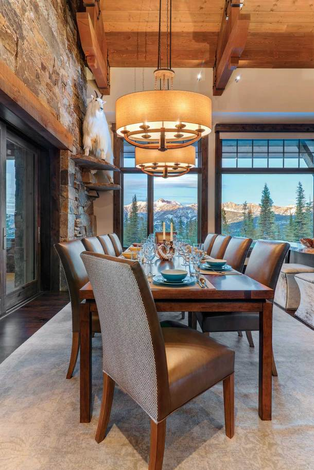 """""""Our clients wanted a fairly large table with plenty of room for gathering family and friends during holidays,"""" said designer Heather Bing. The custom-made fabric and leather upholstered chairs seat 12."""