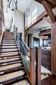 """""""The hinge point of the house is the stair/kitchen area,"""" explained Brooks. It is also a grand design solution to the challenges of the steep, linear lot and the issue of getting light throughout the house."""