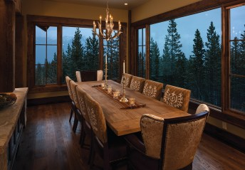 The dining room is located off the great room. Large windows frame the view, which is visible from any seat at the table.