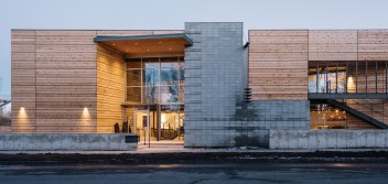 The façade's spaced and floating rain screen siding will be treated to accelerate the gray that results as Western Red Cedar naturally ages.