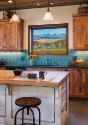 The kitchen window frames a view of the Shields Valley and the Crazy Mountains like a landscape painting. Interior designer Elizabeth Robb cultivated small pops of color to accent an otherwise simple palette of materials, as in the ceramic tile for the kitchen backsplash.