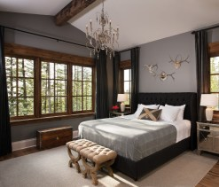 The master bedroom is tucked away on the main floor, just past the great room.