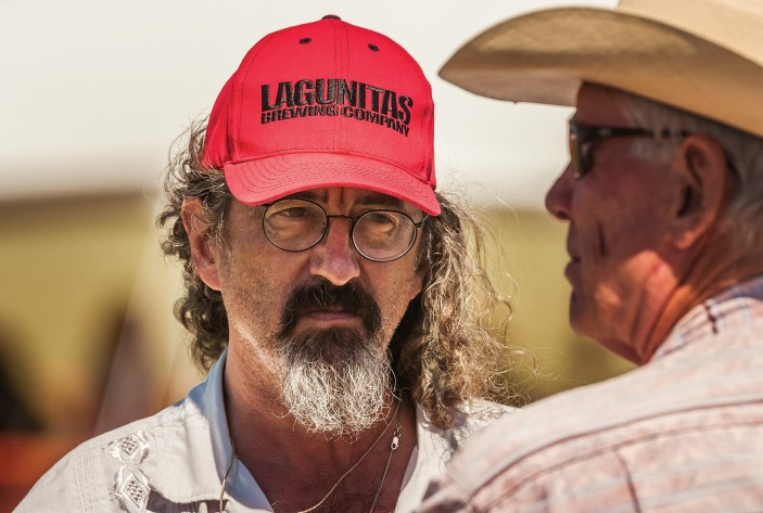 Musician James McMurtry trades stories with Tom McGuane before he goes on stage.