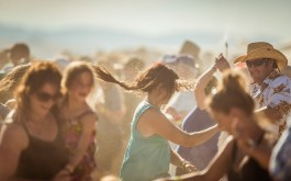 Festival goers dancing in the dust and high heat of Montana summer.