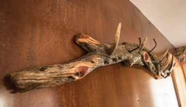 Antler tips and antique nails make for a custom coat rack.