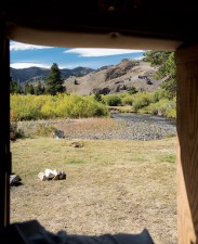 When staring out the backdoor of a fishing camper, few sights are as welcome as a campsite beside a mountain stream.