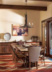 A large table in the dining room offers plenty of space for casual family meals.