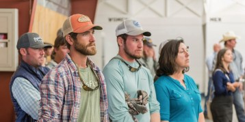 Fishing guides Buddy Holcombe, left, and Tyler Stephens, right, listen at a community informational meeting in Livingston, Montana, in late August of 2016. By at least one estimate, the Yellowstone River closure cost Park County businesses and employees more than $500,000. Photo by William Campbell