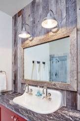 The bathrooms hold onto the rustic charm, complemented by modern industrial fixtures.