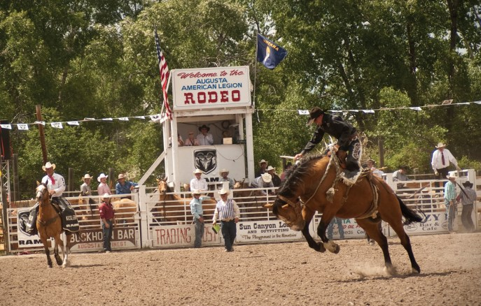 Saddle bronc riding at the American Legion Fairgrounds in Augusta.