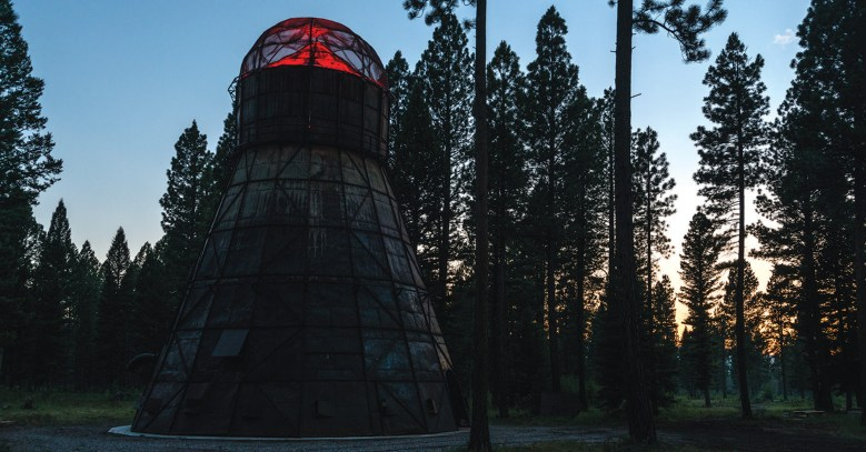 "The installation, ""Montana Memory: Re-imagining the Delaney Sawmill Teepee Burner"" by artist Kevin O'Dwyer, above and right, tells the story of the logging industry in the Blackfoot Valley. At its peak, the sawmill employed over 100 men, but closed in 1971. The teepee burner was a verstige of a previous age, repurposed by O'Dwyer into an art piece. The black and white images used in the interior were funded by the Montana History Foundation."