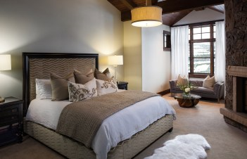 A soft neutral color palette creates a calming effect in the master bedroom.