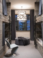 """The second-floor bunk room offers plenty of space and an """"en suite"""" bathroom so that visiting family and friends can feel at home."""