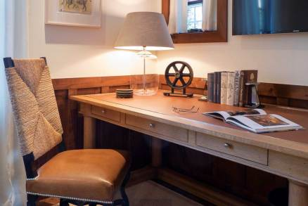 In the office, a leathertopped desk and leathercovered chair add masculine elements to the space.