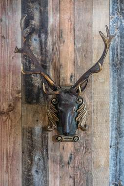 An 18th-Century, wood-carved stag's head from a rare collection marries rustic and European influences.