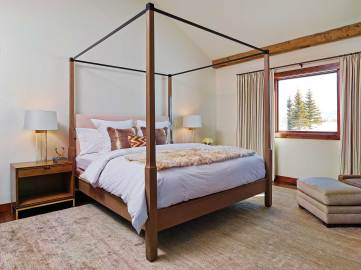 """Homeowner Marie- France refers to the master suite as her """"zen room,"""" where the milk-white elements have become her retreat from busy family life."""
