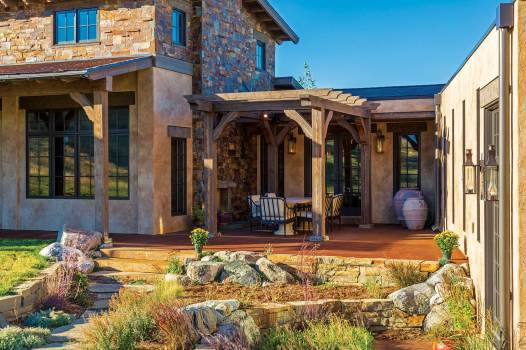 The pergola and patio, warmed by a fireplace, offer a place to entertain and enjoy the views.