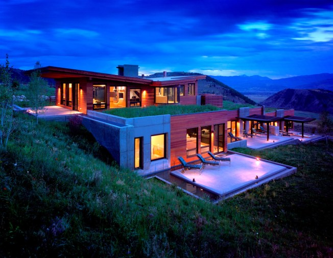 The cascading, grass-covered Warshaw residence unequivocally takes its design cues from its unique sloping Jackson Hole site showcasing unencumbered Teton views.  The house emerges from the land, paralleling the slope of the butte with progressively lower, flat, grassy rooflines.