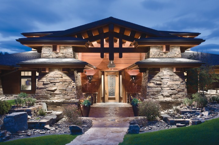The home's front entry incorporates redwood lap siding and custom light fixtures.