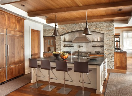 Walnut cabinets match the floor and ceiling in the inviting kitchen.