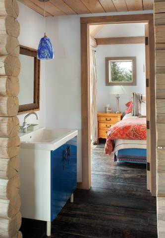 A standalone bathroom sink is positioned outside of the water closet, maximizing space and functionality.
