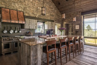 When the homeowner fell in love with a copper and steel range hood from a magazine, designer Catherine Lane had it custom built in Montana.