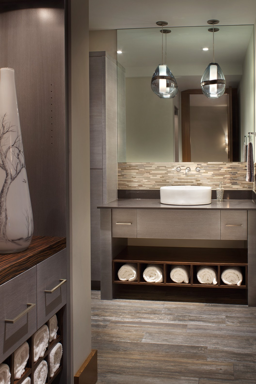 The unique material pallete comes together in a spectacular fashion, even in the powder room.