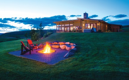 In the evening, LeClair and her family enjoy the outdoors with a sunken fire pit. LeClair design the interior ceiling planes to extend over the decks outside.