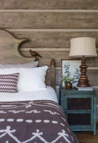 The master bedroom headboard, a wooden slat with an alpine curved top, was created from a picture that Hayes sketched.
