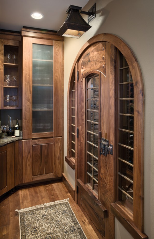 Robertson designed the doors leading into the Soares' wine room.