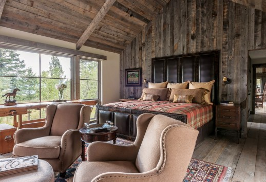 The rustic materials used, such as the wood on the walls of the master bedroom, serve as design elements in their own right, leaving little need for artwork.