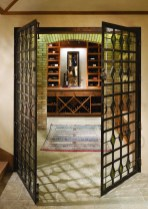 The wine cellar features a custom fabricated, steel gate with stained glass inlay.