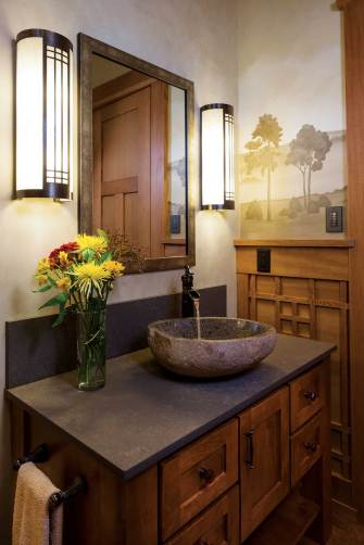Even in the bathroom, Wright's style comes through in the lighting fixtures and natural elements.