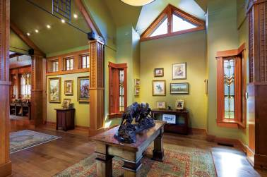 The entryway, filled with bronzes and Western art, opens into a welcoming living room.