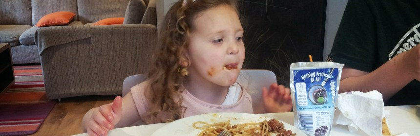 enjoying spaghetti bolognese