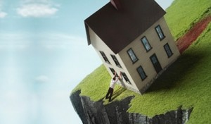 foreclosure_house_sliding_off_cliff