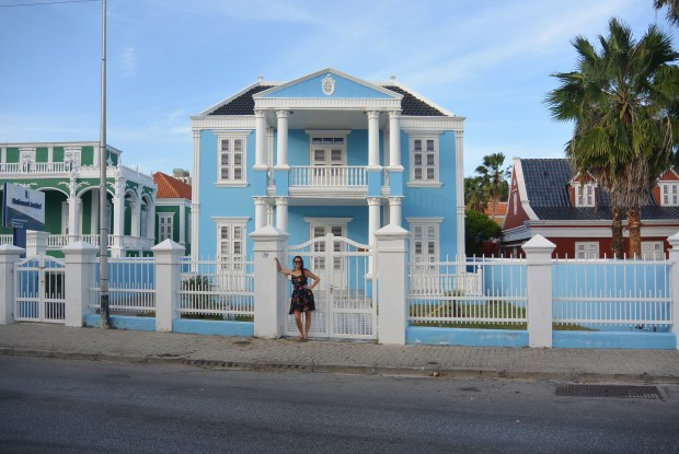 Brittany in front of a blue building