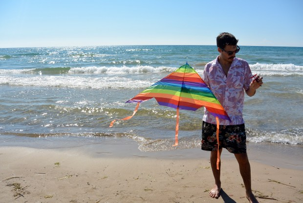 Man holding a kite