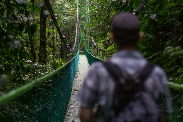 Aaron walking across a Costa Rican suspension bridge