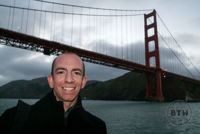 Aaron posing on the Hornblower in front of the Golden Gate Bridge | BIG tiny World Travel