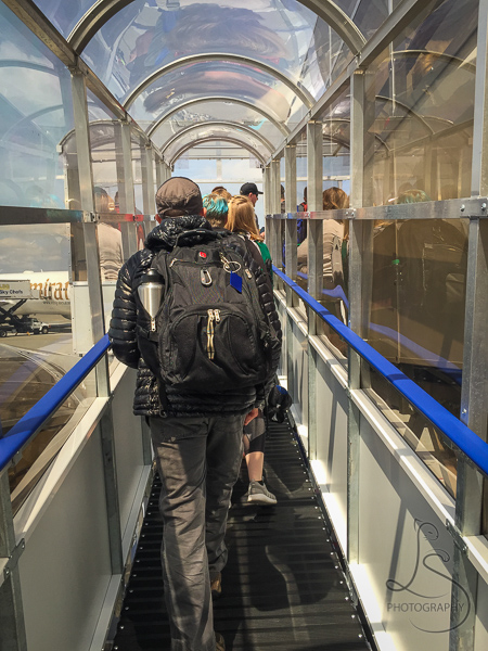 Climbing the covered walkway onto our Norwegian flight | BIG tiny World Travel
