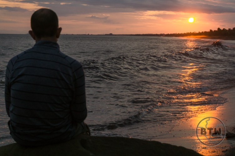 Aaron silhouetted against the golden sunset over the Costa Rican coast | BIG tiny World Travel