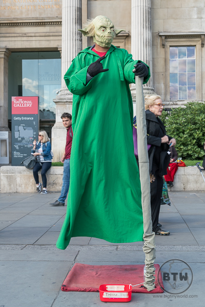 A busker dressed as Yoda in London