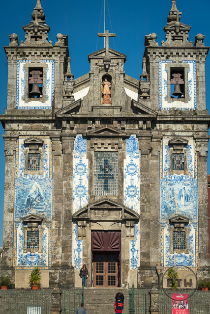 The front of the Sao Ildefonso Church, featuring blue and white azulejos, in Porto, Portugal