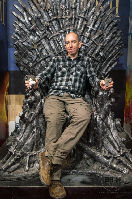 Aaron sitting on a Game of Thrones Iron Throne in Split, Croatia